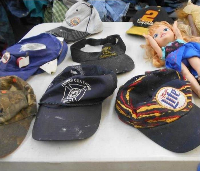 collection of hats damaged by smoke