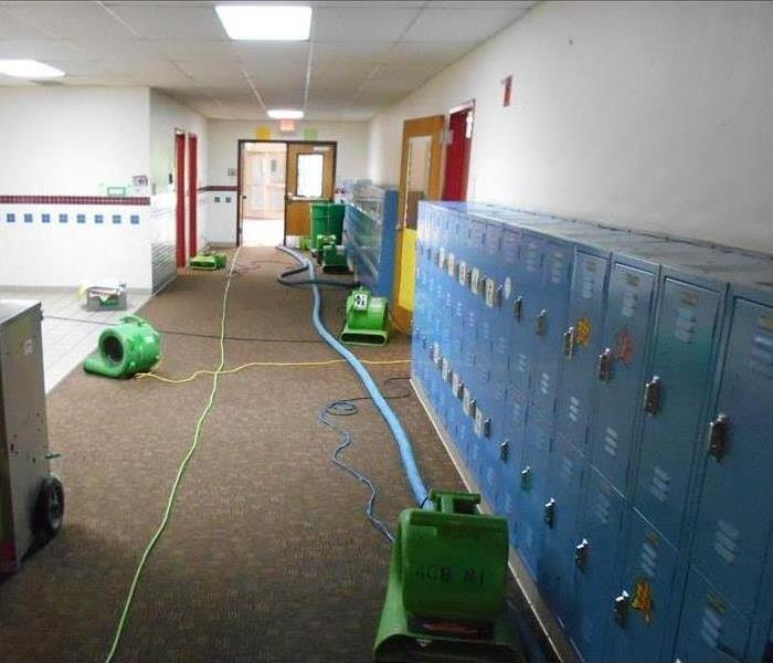 school hallway with lockers after water damage has been dried